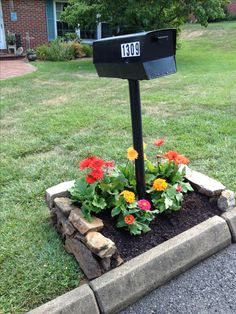 Flowers around mailbox. Change with seaons. Found rock for border.
