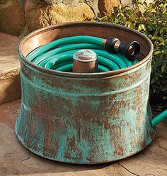 10 stylish garden hose storage options.