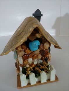 Bluebird cottage. Stone with clay 'thatched' roof and bluebird. All handmade by J C Adams. $ 45 Available online or at the Green Door Nursery in Naples, Fl.