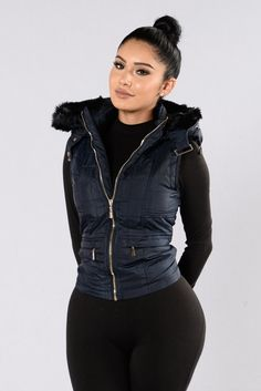 - Available in Navy - Hooded Vest - Fur Trim Hood and Inside - Sleeveless - Zipper Front - Zipper Pockets - Drawstring on Hood - Back Slit - 100% Polyester