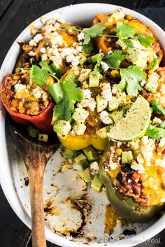 These delicious Vegetarian Enchilada Stuffed Peppers are made with brown rice, corn, and beans smothered in enchilada sauce and stuffed into colorful bell peppers. They are an easy to make and healthy dinner recipe that is naturally gluten-free and can easily be made vegan. | theendlessmeal.com