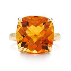 Tiffany & Co. Orange citrine stone on an 18kt-yellow gold setting. I think I just found what I want for an engagement ring!