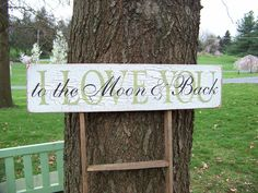 I Love You To The Moon and Back Crackled Distressed Wood Sign. $30.00, via Etsy.