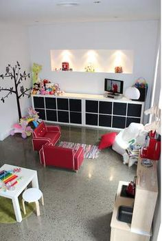 Like this modern playroom - we actually have the exact same retro couch, stools & Ikea kitchen & storage cubes!