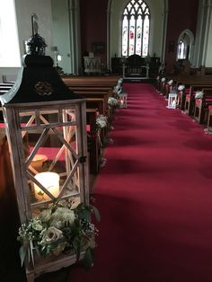 Posy Barn large lantern with flowers in church aisle