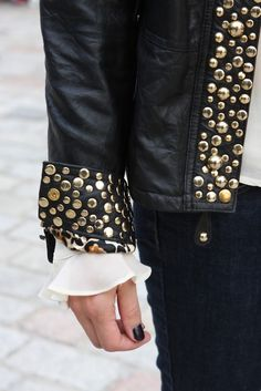 Leather gold studded jacket with a peek of animal print