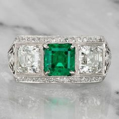 Jewelry Rings Alyce - The Alyce Ring is a vintage Colombian emerald engagement ring circa This extraordinary ring centers a GIA Certified ct Colombian emerald with minor clarity enhancement. To each side is a stunning ct Asscher cut diamond. To the north Art Deco Diamond Rings, Art Deco Ring, Art Deco Jewelry, Diamond Jewelry, Jewelry Rings, Fine Jewelry, Jewlery, Solitaire Rings, Emerald Cut Engagement