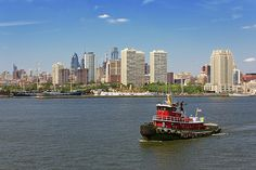 Camden, NJ - This is the Philadelphia Skyline, as seen on the Battleship New Jersey, in Camden, NJ. The Delaware river is alive with boats and other nautical machines. In the front is a tug boat, it's job is to push other boats around. The boats in the background, are now tourist hot spots and restaurants. But they were once real boats that were used daily in these very waters. #savad #tugboat #philadelphia