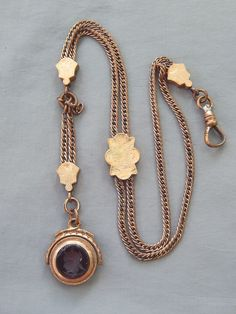 """Antique Victorian gold filled pocket watch slid chain and fob. It is 14-1/2"""" from end to end and has a working swivel. You can see in the pics that the gold fill shows wear and it needs polished. The chain has extra slack on one side and I don't know if it was made this way or needs adjusted."""