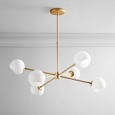 Design a comfortable living space with west elm sofas, which come in a variety of styles. Rectangle Chandelier, Glass Chandelier, Chandelier Lighting, West Elm, Mirror Wall Art, Room Planning, Candelabra Bulbs, Small Furniture, Modern Furniture