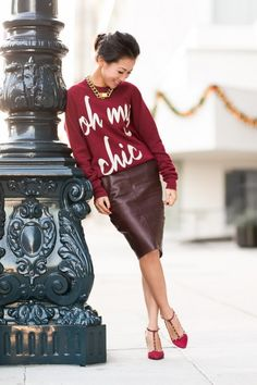 Dress up a graphic sweatshirt with a (faux) leather pencil skirt and matching pumps.