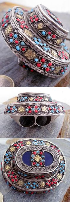 Central Asia | Old Uzbeck Silver, gold wash, coral and turquoise double ring | ca. first half of the 20th century | This ring would have been used as a talisman to protect the wearer and most probably would have been part of a bride's dowry.