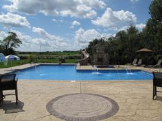 Custom L Shaped Pool designed by Aqua Pools and built in Orland Park, IL