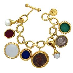 Impressive Elizabeth Locke Gold Charm Bracelet | From a unique collection of vintage charm bracelets at https://www.1stdibs.com/jewelry/bracelets/charm-bracelets/