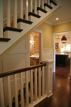 Keep staircase open with railing A basement door remodeled and wall opened to give an open feel..I love this idea!!