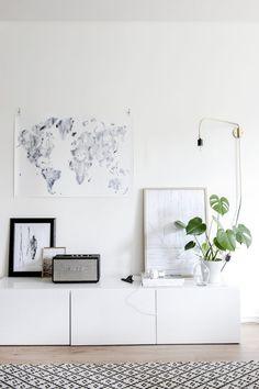 Storage / art and Menu wall light in a Helsinki home