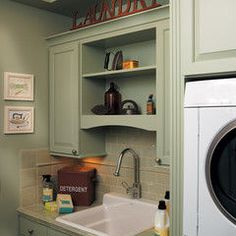traditional laundry room by Canyon Creek Cabinet Company
