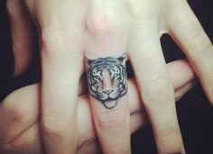 Tiger Finger Tattoo