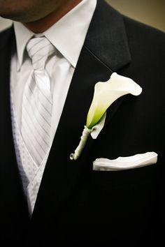 Amber & Tom - #groomsmen #calla #lilly Not a fan of the calla lilly but love the suit!