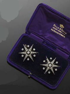A pair of diamond star brooches Each brooch centred by a claw set old-cut diamond, with six rose-cut diamond set rays, alternately spaced by knife-edge bar spacers, each terminating in a rose-cut diamond within a pinched collet mount, with detachable brooch fittings, in fitted case bearing retailer's signature for 'Poile & Smith'