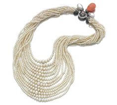 FROM THE COLLECTION OF DAISY FELLOWES - Pearl, coral and diamond necklace, Monture Cartier, 1930s -  Composed of thirteen rows of graduated pearls measuring approximately from 2.7 to 6.9mm, the clasp highlighted with a grey pearl bordered by circular-cut diamonds together with two pearls and one coral drop capped by rose-cut diamonds, length of the shortest row approximately 430mm, French assay and maker's marks, signed Monture Cartier.