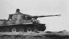 Tiger 'S21' of the Das Reich Division moves forward at Kursk to consolidate the positions on the exposed Russian steppe in July 1943. The tank is painted in Sand Yellow oversprayed with Red Brown and...