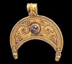 Hellenistic gold and garnet lunate pendant.