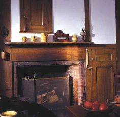 An early original kitchen fireplace.
