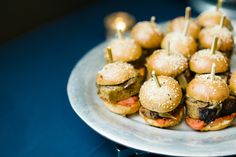Ravishing Radish Catering's Cajun meatloaf sliders with caramelized onions & spicy ketchup on a brioche bun. Hello late night snack! Angela + Evan Photography.