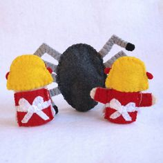 Made from 100% wool felt, this finger puppet is 2.5 inches tall. Each piece is hand cut and sewn together one tiny stitch at a time. Attention to detail is given to both the front and the back. No glue or beads are used. This set includes: - spider - Little Miss Muffet eating her