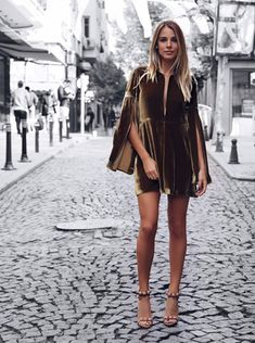 A velvet dress will always be a classic Christmas style, and will look utterly chic paired with bare legs and heels, as seen here. However, for a style more suited for the winter cold, why not wear this trend with tights and a classic trench coat for a festive and stylish look. Via Aysegul & Yasemin.   Brands not specified.