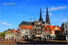 Town square of Delft, Holland. The city is famous for its beautiful Delft Blue pottery (Delftware).