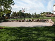 Even #basketball courts can look elegant! #retainingwall #naturalrock #landscape
