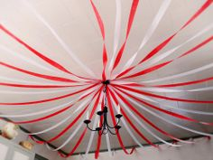 Red and white streamers to create a tent. Everywhere Fun Fair - Vacation Bible School #everywherefunfair #vbs #cokesbury