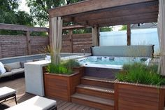 Wooden Deck With Hot Tub Retreat Using Wooden Pergola With Curtain And Outdoor Seating Added With Built In Wooden Planters With Custom Hot Tubs Designs  Also Hot Tub Under Deck                                                                                                                                                      More