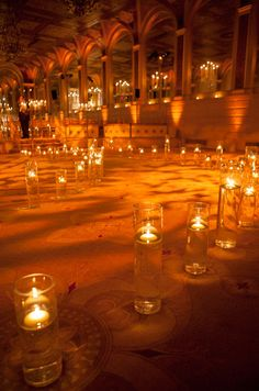 This wedding aisle is comprised of countless floating candles that give off a warm amber glow.