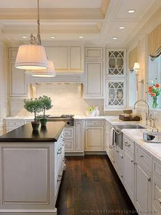 Light sconces by sink...white cabinets dark floors