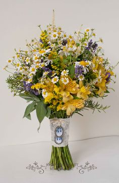 Garden relaxed Bridal Bouquet. Yellow slstromeria, lavender, tanacetum, camomile and herbs.