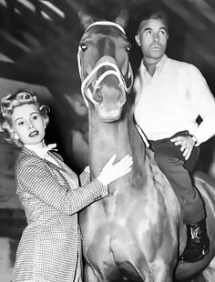 Zsa Zsa Gabor with Dominican playboy and longtime obsession Porfirio Rubirosa, at a stable outside Paris, April 1954.