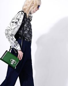 Mini Pilot bag in green calfskin adorned with the Emilio Pucci monogram in white.