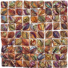 Inchies, one-inch square polymer tiles, have become all the rage for swaps among artists.This set of fall leaves from Mama Tierra was part of the trading flurry at the EuroClay Carnival in Madrid. Repeat a technique 81 times and you're bound to [...]