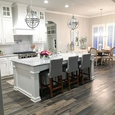 White Kitchen with grey-stained hardwood floors White Kitchen with grey-stained hardwood floor ideas #WhiteKitchen #greyhardwoodfloors