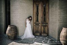 Beautiful wooden doors at Rippon Vineyard, Wanaka, make for a stunning wedding photo backdrop. Photography by Alpine Image Company