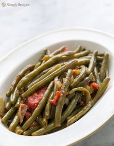 Green Beans with Tomatoes and Bacon ~ Pioneer Woman's slow cooked fresh green beans with tomatoes, bacon, and onions. A great Thanksgiving side! ~ SimplyRecipes.com