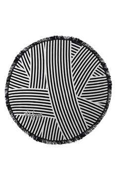 Round beach towel: http://www.stylemepretty.com/living/2016/06/20/10-summer-splurges-thatll-put-you-in-vacation-mode/