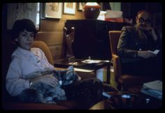 Family seated in a living room with their dog, 1972