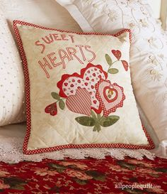 A Valentine pillow will make its recipient feel especially loved. Fused,  machine appliquéd heart flowers and embroidered letters embellish this token  of affection.