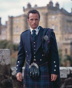 Spirit of Bannockburn Kilt, Blue Prince Charlie Jacket, High Button Waistcoat, Victorian Collar Shirt, Navy Ruche, Navy Sporran and Plaid and Brooch.    http://www.binghamsmenswear.com/highland-wear.html