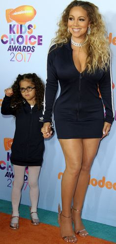 "Mariah Carey and daughter Monroe wearing matching striped Adidas mini dresses and Sophia Webster ""Chiara"" rose gold shoes at the 2017 Kids' Choice Awards"