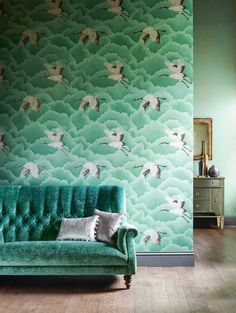 CRANES IN FLIGHT WALLPAPER  This elegant crane wallpaper from Harlequin's Palmetto collection makes a real statement in this emerald colourway.